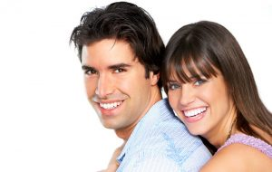 Smiling couple illustrating the good of cosmetic dentistry